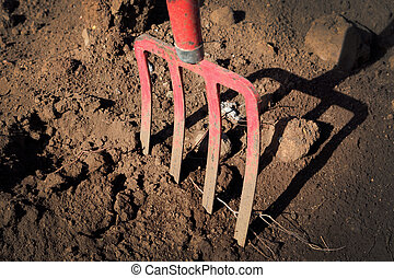 gardening fork in the ground - pitchfork in sand