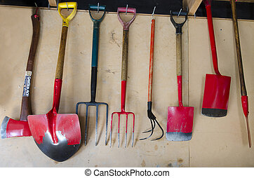 Gardening - Garden Tools - Garden tools hangs on a garage ...