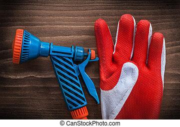 Gardening glove and garden water pistol agriculture concept
