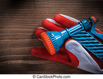 Gardening glove and water spray nozzle agriculture concept