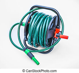 Gardening hose with nozzles isolated on white background