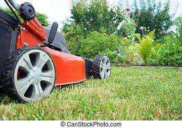 gardening - Lawn Mower on a meadow in a garden