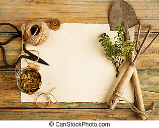 Gardening tools and blank paper