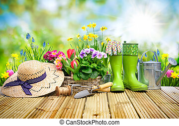 Gardening tools and flowers on the terrace