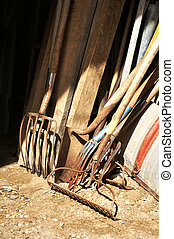 Gardening tools and wood stored in the barn