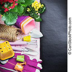 Gardening tools on a black background