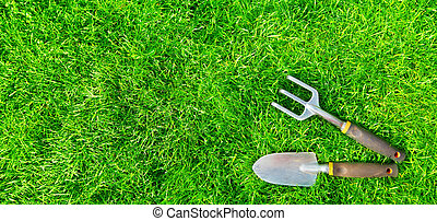 Gardening tools on green grass. Spring and summer background...