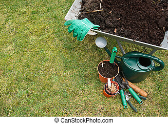 Gardening tools on the lawn - Gardeners utensils on a grass ...