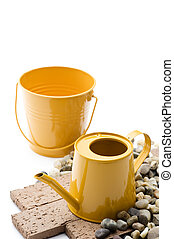 gardening tools - Yellow backet and watering can of...