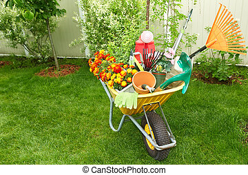 Gardening tools. - Wheelbarrow with Gardening tools in the ...