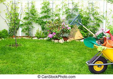 Gardening tools. - Wheelbarrow with Gardening tools in the ...