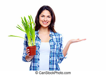 Gardening woman with plant.