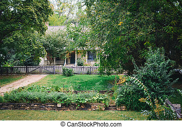 Gardens and house in the Old Salem Historic District, in Winston-Salem, North Carolina.