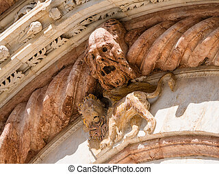 Gargoyle and lion on facade of Siena Cathedral - Ghastly...