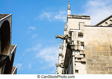 gargoyle on facade of church in Troyes city