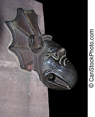 Gargoyle on the side of a church at night in Strasbourg, French/German border. With clipping path!!