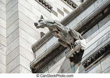 Gargoyle statue on Basilica Coeur Sacre on Montmartre in...