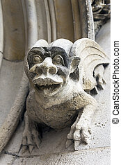 Gargoyles on the wall of a medieval building.