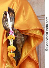 Garland in the hands of the Buddha