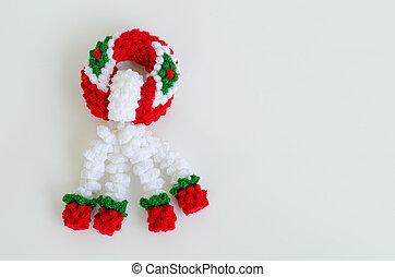 garland knitting on white background