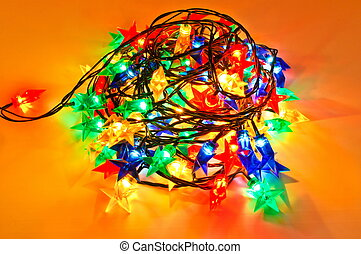 Garland of colored lights for Christmas trees. Spread out to...