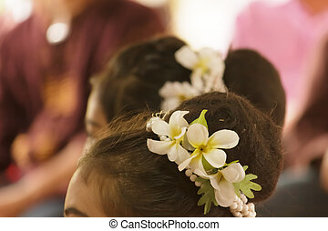 Garland of flowers on her head