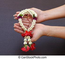 Garland of jasmine flower on hand
