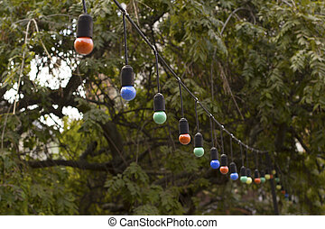 Garlands of color lamps hanging on the summer terrace