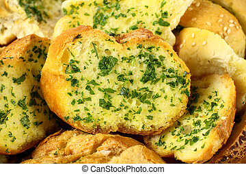 Delicious homemade herb and garlic crusty bread ready to serve.