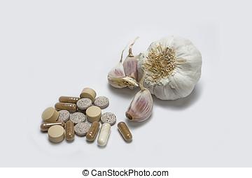 Garlic and herbal supplement pills, alternative medicine concept