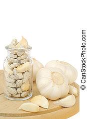 Garlic and herbal supplement pills isolated, alternative medicine concept