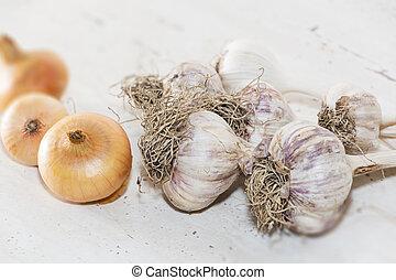 Garlic and onions. Fresh garlic on a light background