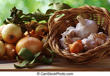 garlic and onions on table and basket