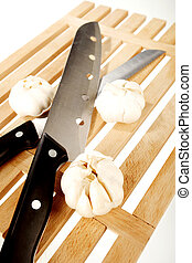 Garlic and two knifes