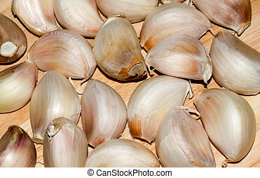Garlic Background on brown wooden
