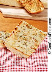 garlic bread on checkered napkin