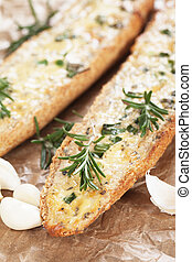Garlic bread with butter and rosemary