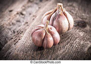 garlic bulb on rustic wooden background - garlic bulb on...