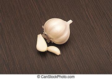 Garlic bulb with black background.