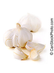 Garlic - Bulbs and cloves of garlic isolated on white...