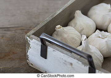 Garlic bulbs in box