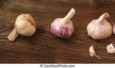 Garlic bulbs on wooden board, natural medicine, eat healthy...