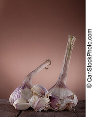 Garlic Bulbs on wooden table