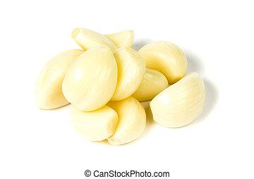 Garlic clove - Shelled garlic cloves a hill folded isolated...