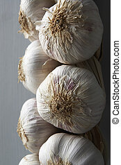 Garlic Cloves Hanging From String