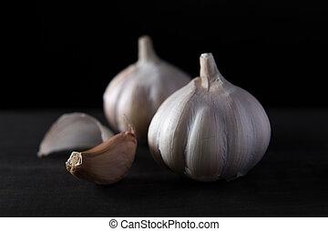 Garlic cloves on wooden vintage background.