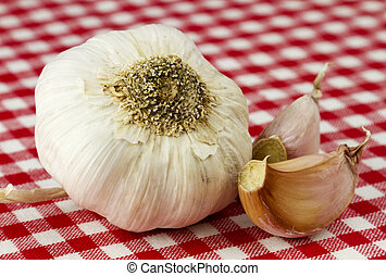 Garlic - Fresh garlic isolated in red and white checkered ...