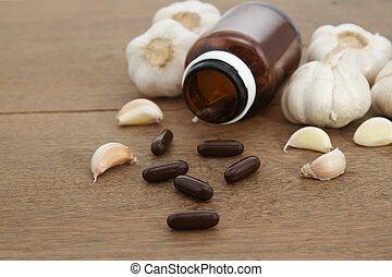 Garlic  herbal supplement pills , alternative medicine