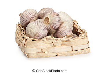 Garlic in a basket isolated on white background