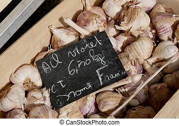 garlic in a box, at the market